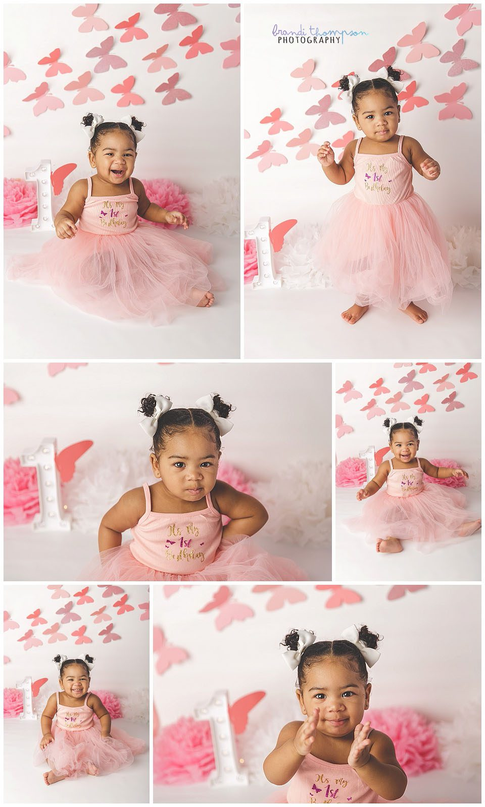 Pink and white butterfly themed cake smash with one year old girl in pink dress