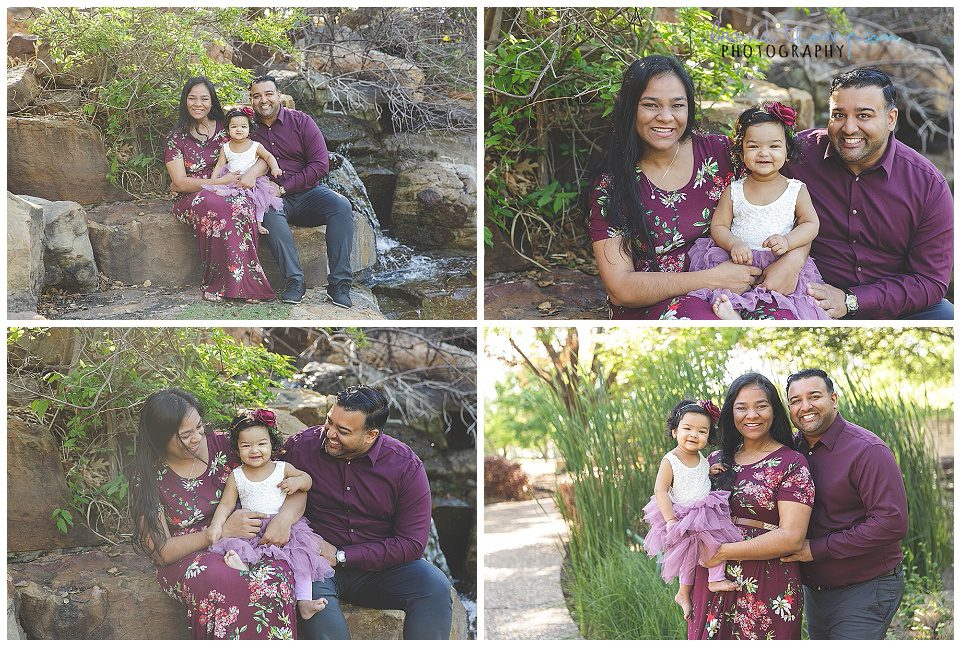 outdoor family photos in a park with a south asian family with mom, dad and baby girl. They are wearing shades of maroon and purple
