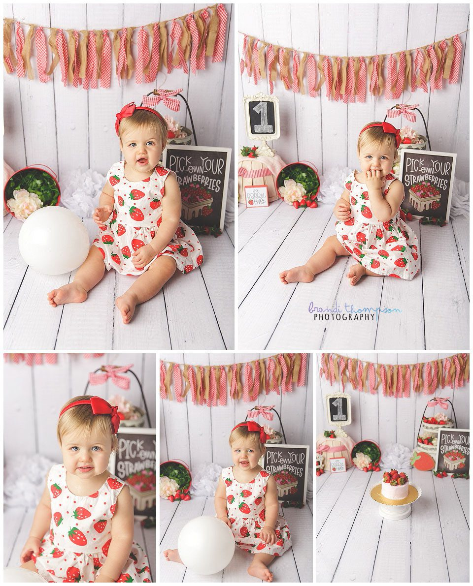 first birthday cake smash for blond one year old girl in red and white gingham and strawberry theme